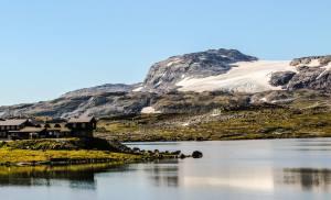 Bergen rail line, Finse station with the glacier. Photo by Rita de Lange, Fjord Travel Norway