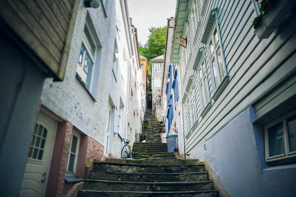 Small street in Bergen by Cole Rise Visit Bergen