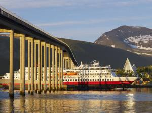 Hurtigruten in Tromso at midnight. Photo by Baard Loeken, Nordnorsk Reiseliv