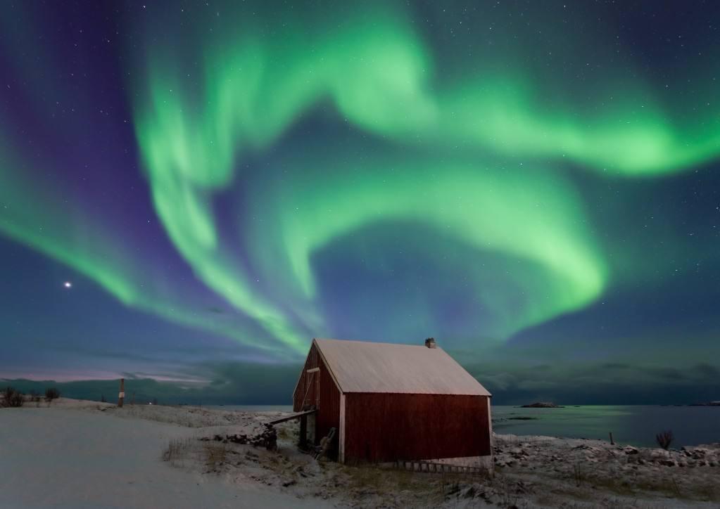 Northern Lights in Arctic Norway. Photo by Oystein Lunde Ingvaldsen www.nordnorge.com