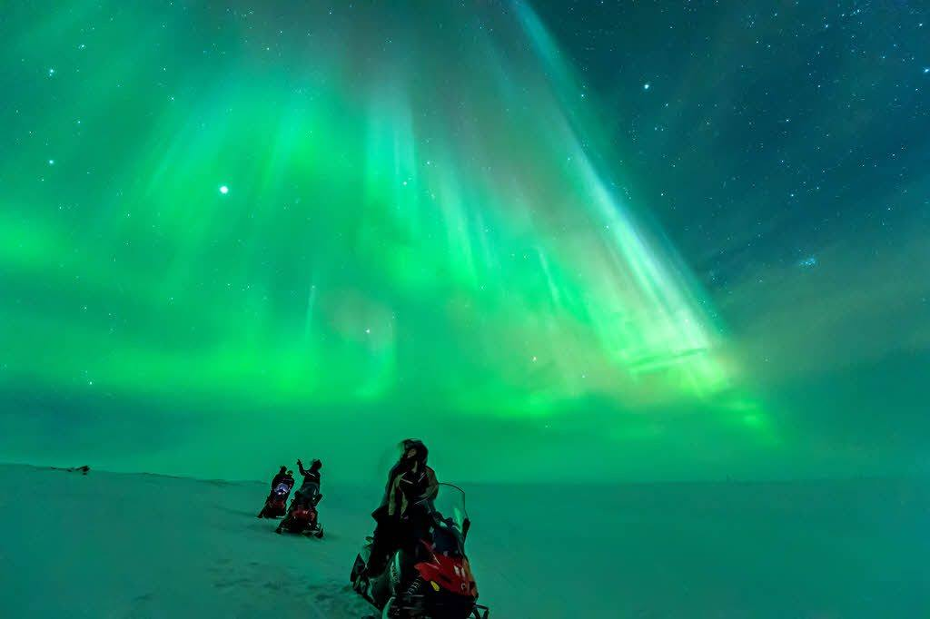 Northern Lights during a snowmobile trip by Orjan Bertelsen, Hurtigruten