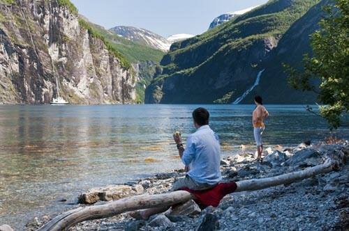 Relaxing on the shores of Geirangerfjord by CH, Visit Norway