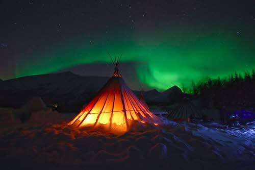 Traditional tent under the Northern Lights by Lyngsfjord Adventure