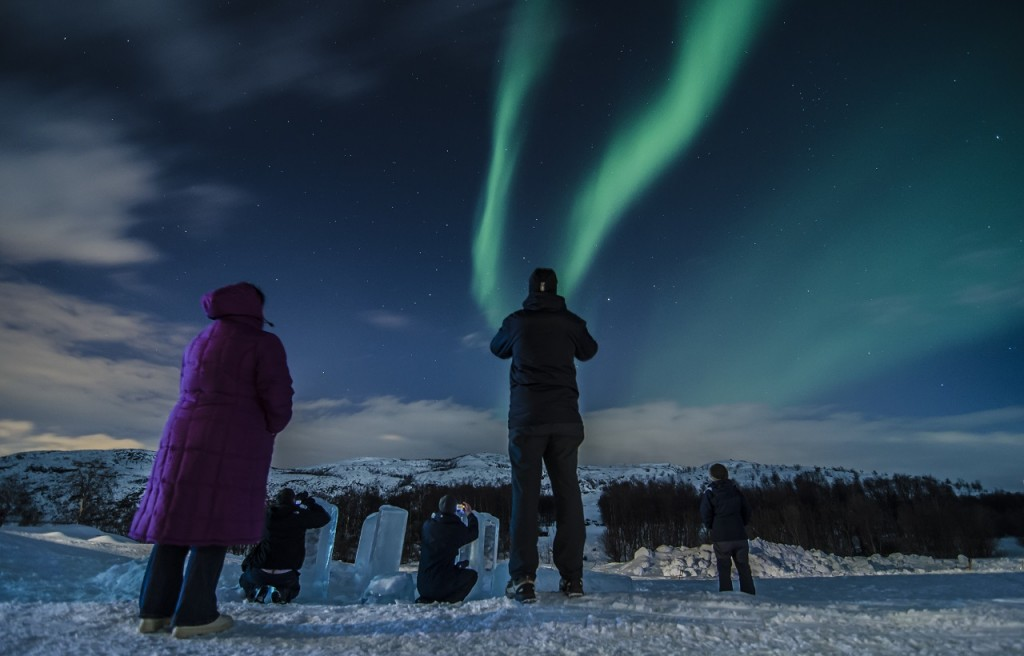 Spotting the Northern Lights outside the Snow hotel. Photo by Gioel Foschi