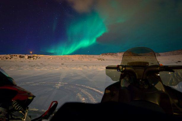 Snow mobile in the Polar night. Photo by Kevin Richardson, Hurtigruten
