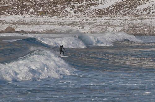 Winter surfing at Unstad Lofoten by CH, Visit Norway